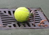 Tennis_ball_in_drain