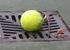 Tennis_ball_in_drain